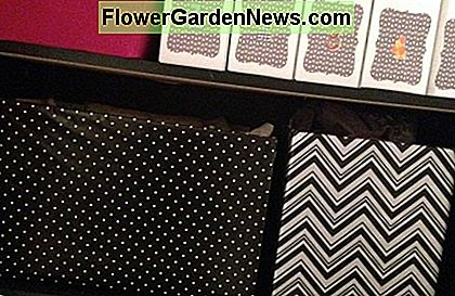 Polka Dot and Chevron Paper used to cover boxes on the craft wall!