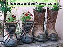 My recycled old boots flower pots
