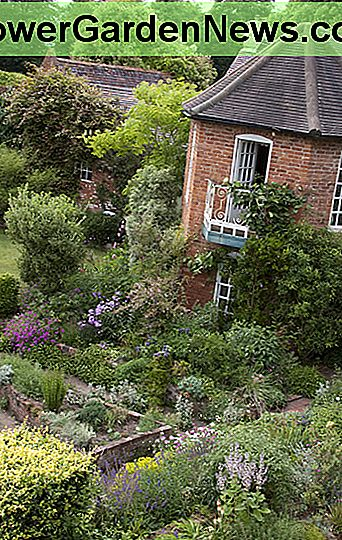 The outdoor rooms in English style. Sissinghurst is well known for this design full of well-thought plantings.