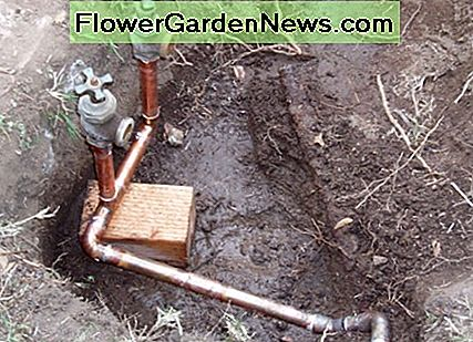 With this sprinkler pipe redesign, two copper pipes on different levels had to be soldered together with two elbows. Changing directions also requires soldering an elbow.