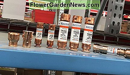 Here you see fuses rated for different amps as well as the differences in physical size and how fuse reducers (far left and right) can help fit new smaller fuses to old disconnects.