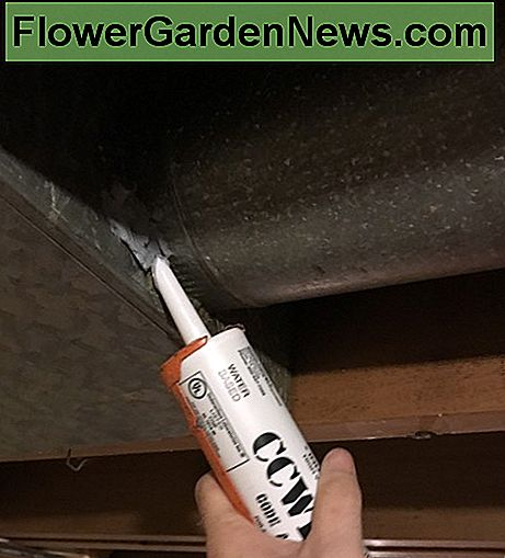 Begin applying mastic up as high as you can get your caulking gun.