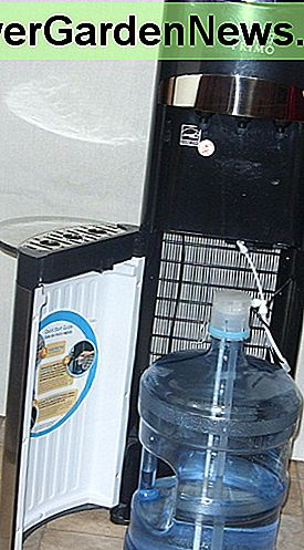 The water bottle fits inside on the bottom and water is siphoned up to the top for dispensing.
