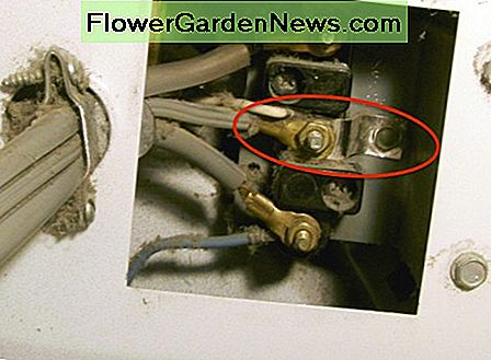 What the three-wire connection will look like, including a metal ground strap (circled) between the dryer frame and the white wire. You can use a #10 wire instead of a strap.