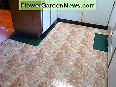 Filling the floor in with vinyl tiles