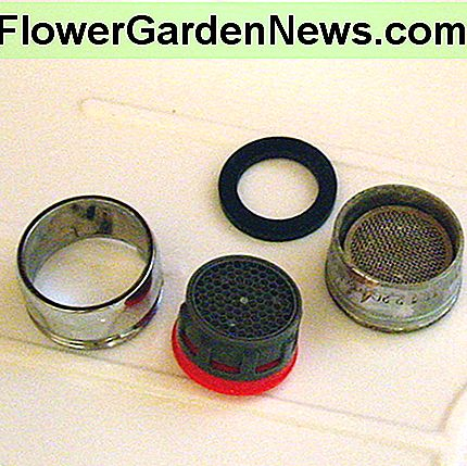 Replace your old faucet aerator with a new, low-flow one. Note that the new one is plastic, whereas the old one is steel mesh that rusted.