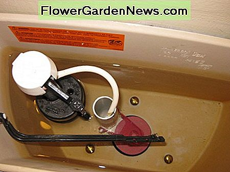 Note the three screws in this Kohler toilet. It requires a triangular tank to bowl gasket that is specific to this brand of toilets.