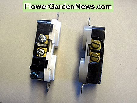 The difference in termination screw color: The screws shown on the left will get the white wire(s), with the ground wire going to the screw near the bottom of the photo. The screws on the right need the black wires.