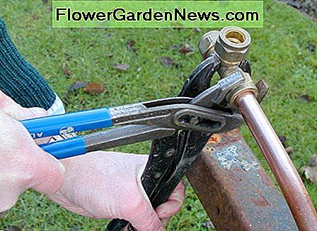 Tighten 1/2 to 1 turn with a wrench, Stilsons or water pump pliers. Hold the fitting also to prevent it turning