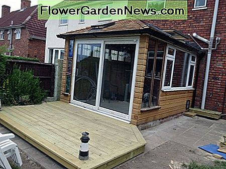 Patio doors of conservatory leading onto decking.