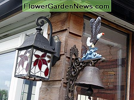 Exterior conservative lighting; and ornate functional cast iron bell.