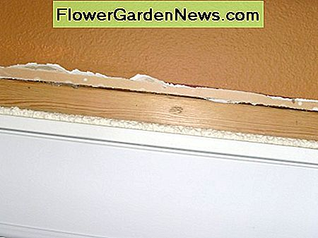 Foam caulking has been used in the gap at the top of the door. It, too, needs trimmed flat with a knife.