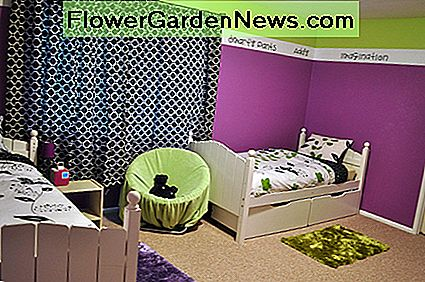 Black print curtains and a stripe of lime green around the top of the room help break up all the bright purple.