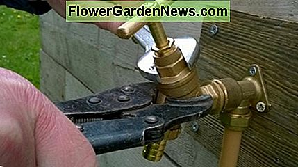 Using a locking pliers to hold the body of an outside tap while undoing the top
