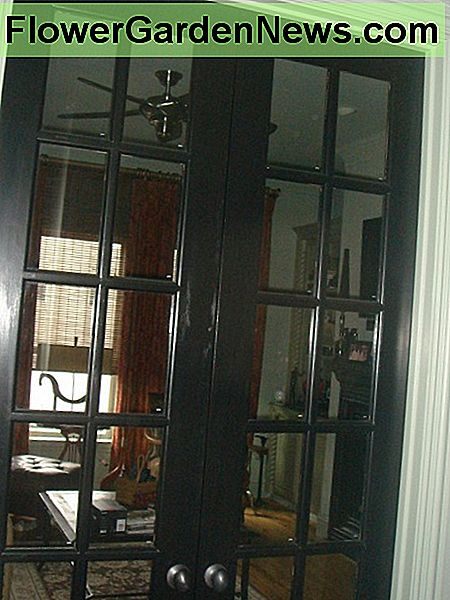 Interior French doors add privacy to a den without creating a closed-off feeling.