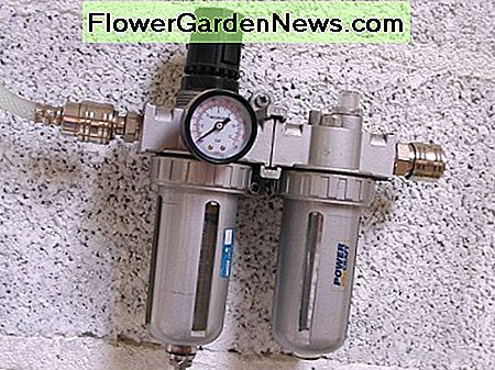 Filter, regulator, lubricator unit. The filter has an automatic drain for releasing water when pressure is released
