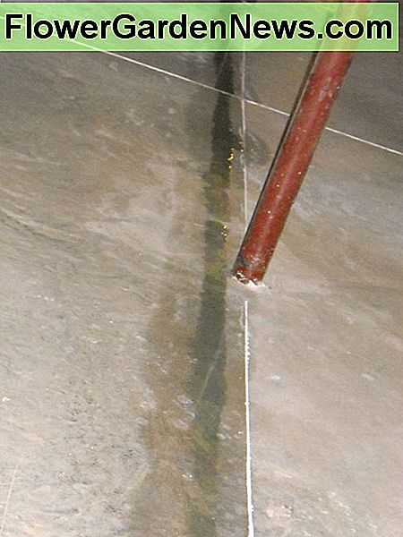 Trail of water from sweating plumbing pipes.
