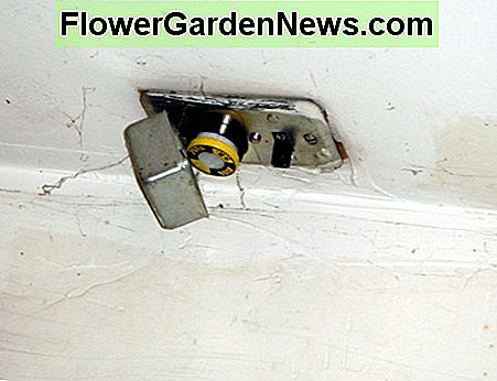 This fuse/switch combination is mounted in a garage ceiling to control and protect an attic exhaust fan.