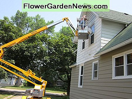 Using a Boom Truck to Paint the Exterior of a Two Story House