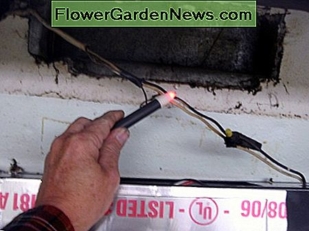 Checking the power - this wire is hot and must be shut off at the circuit breaker. The lower area with silver tape is the