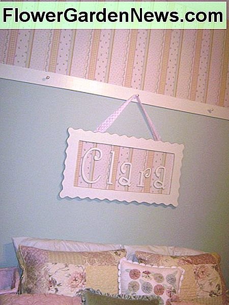 A chair rail can be installed 24-30 inches from the ceiling for a different look. In this bedroom, wallpaper was used above the rail, and paint was used below. Pegs were added to the rail for a little something extra.