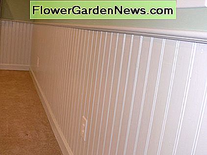 Traditional white wainscoting courtesy of www.bluewatercustom.com