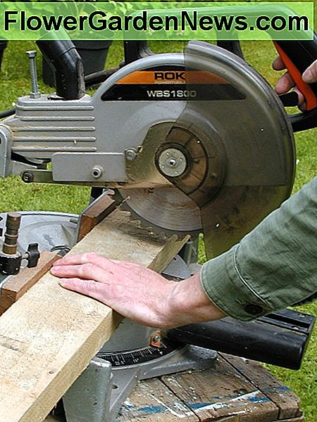 Cutting with a miter saw. The guard retracts when cutting and should return when you raise the cutting head