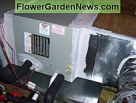 This air conditioning unit's duct system uses a galvanized sheet metal plenum with flex duct take offs.