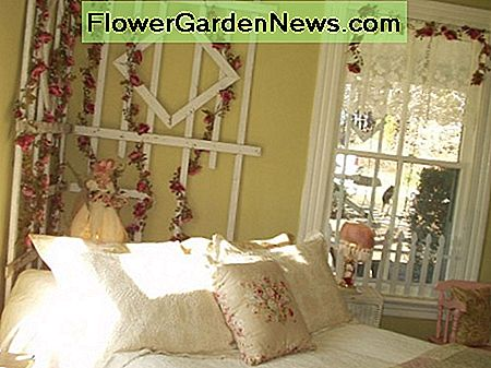 The bed linens include a feather bed, Matelasse bedspread and a rose design quilt. My daughter used an old trellis from her front porch and added a silk rose garland.