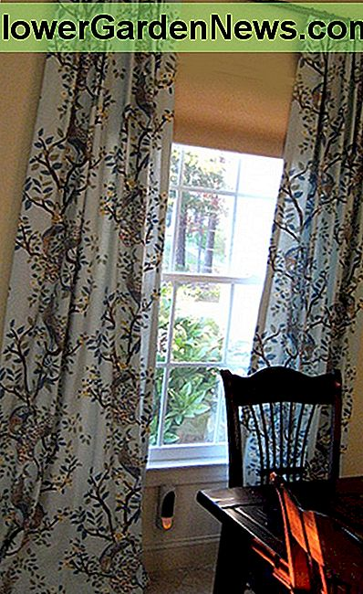 Example of curtains that exceed the width and height of a window.
