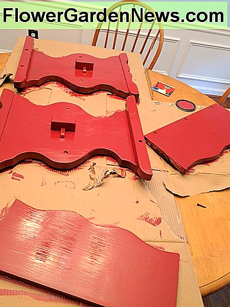 I painted each of the base pieces red. While these were drying, I added a coat of polyurethane to the table top. I didn't stain the table top because we really liked how the natural wood looked.