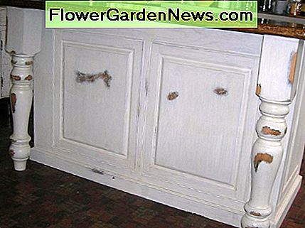 Example of a distressed finish on a kitchen island.