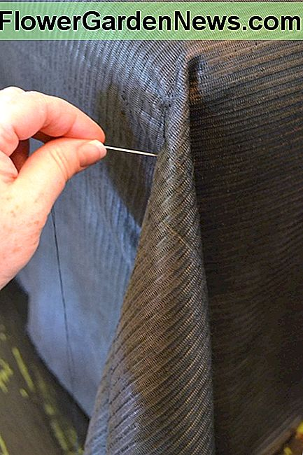 Hand stitch the corners from top to bottom as pinned, removing the pins as you go.