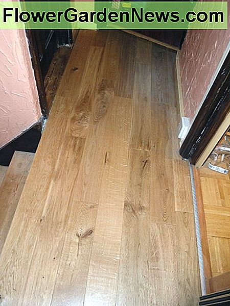 The new oak floorboards on the upstairs landing
