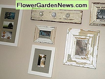 Plan your arrangement before hanging wall art.