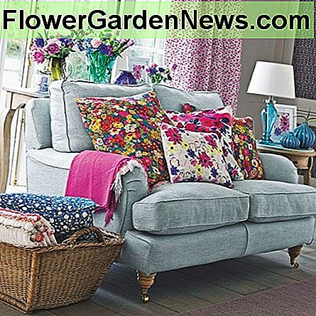 The floral theme ties the colored items in the room together.