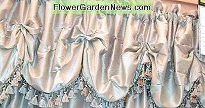 A silky scalloped valance with fringe looks great in a formal room.