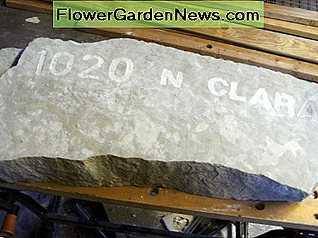 Stone slab to be made into a sign. Engraving has been started already.