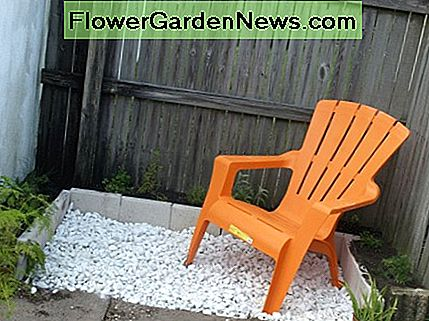 With the addition of marble chips and the Adirondack chair - a little color in orange - the herb garden is complete and ready for a relaxing morning cup of coffee.