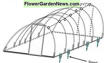 Building cheap greenhouse - putting the entire structure in place.