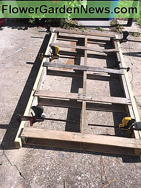 The Pallet ready for rebuild with the 2x4 PT ready for gluing and screws