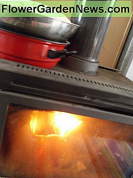 This basic slow combustion heater is put to work helping dough rise. The bowl is elevated from direct heat.