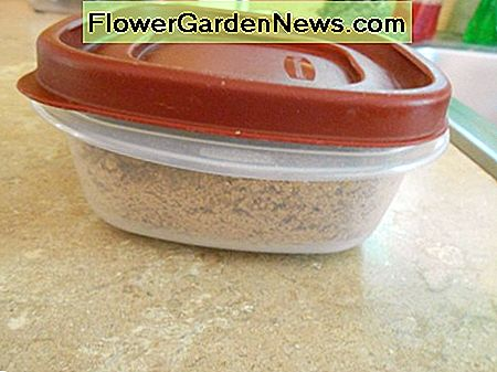 Nutritional yeast stored safely in an airtight plastic container.