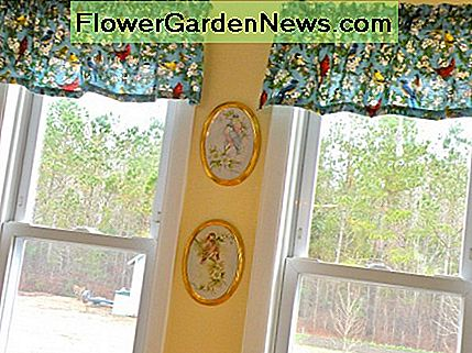 Bird print valences were made out of inexpensive fabric. Hand painted plaques carry out the bird theme.